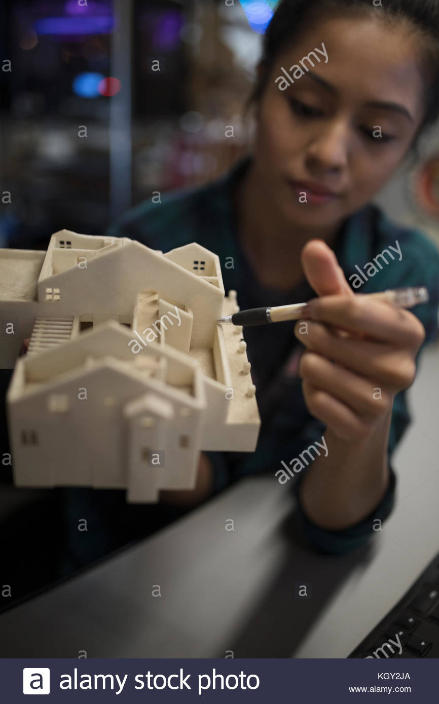 Close up female architect welding architectural model - Stock Image