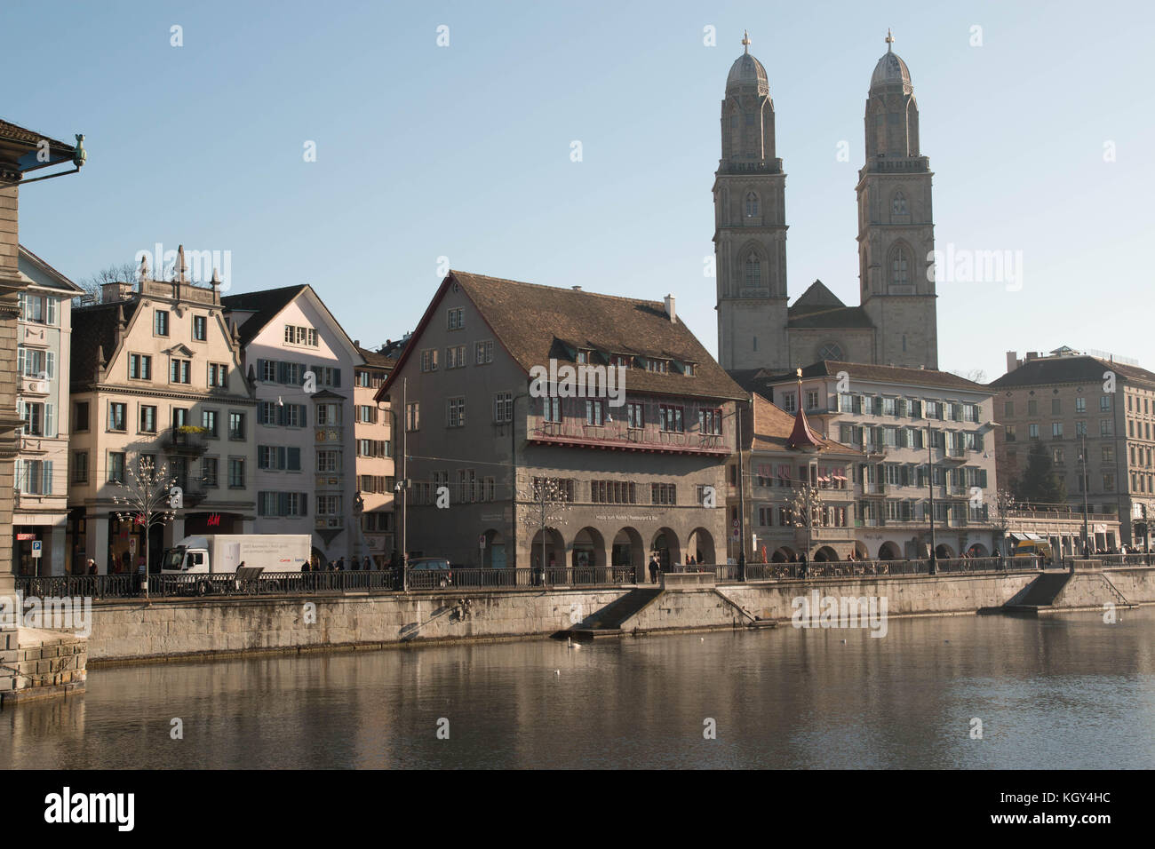 Zurich landscape with river Limmat and munster cathedral - Stock Image