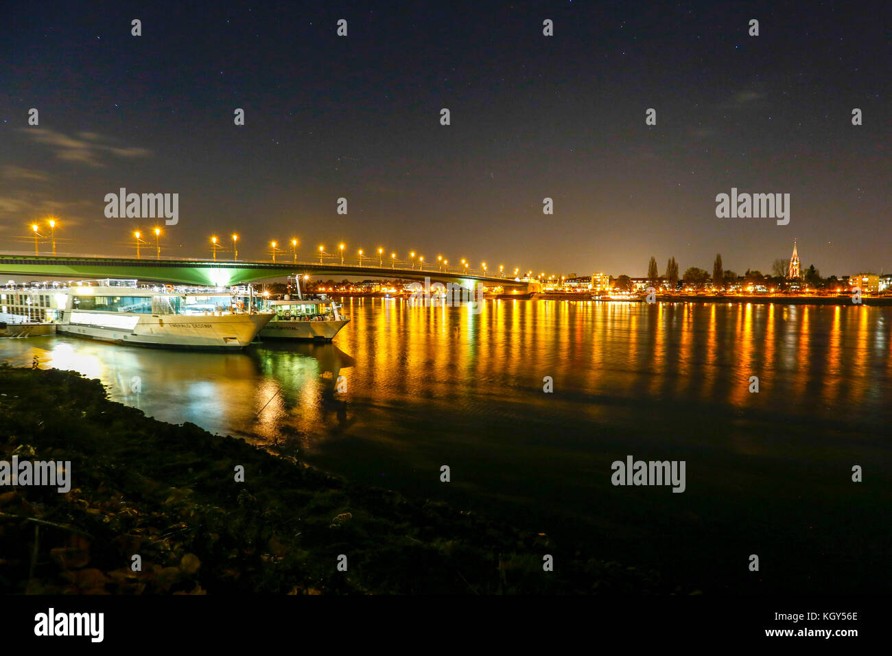 Night view of the Rhein River at Bonn in Germany. - Stock Image