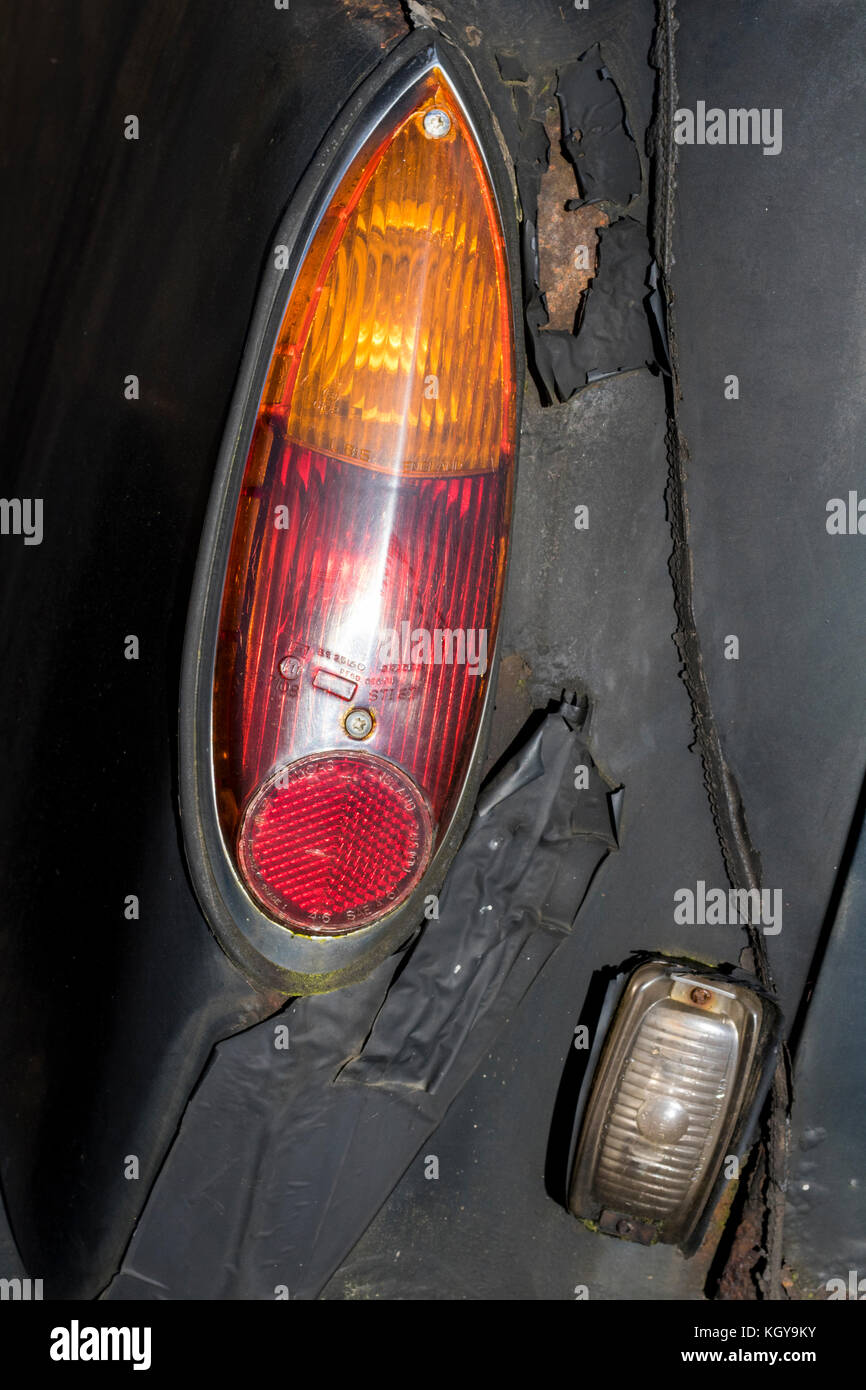 Black Cab to Nowhere: Rear Light Detail on an Abandoned Rusting and Dilapidated London Cab. - Stock Image