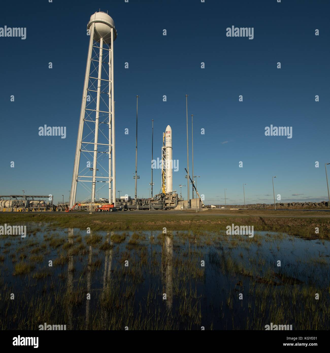 The Orbital ATK Antares rocket carrying the Cygnus space capsule is readied for launch Pad-0A at Wallops Flight - Stock Image