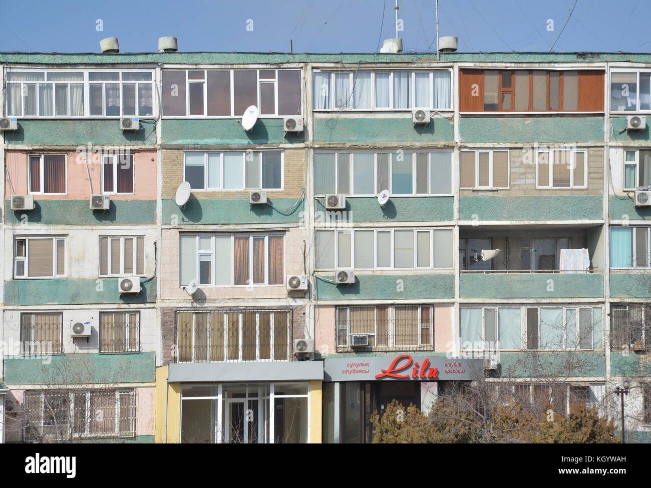 colorful apartment building from soviet-era in Aktau Kazakhstan next to the Caspian sea. Krushchyovka building. - Stock Image