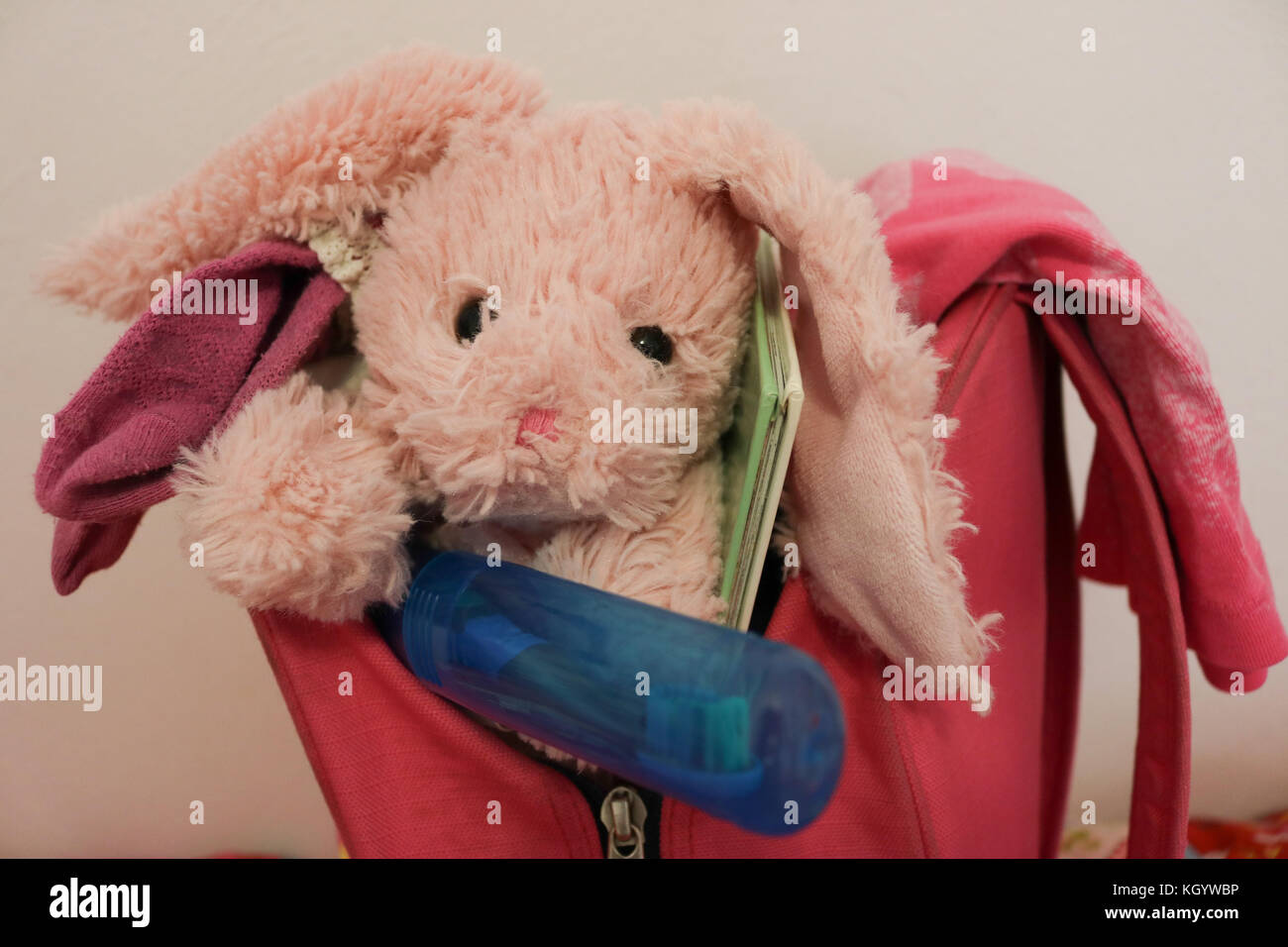 Close up of a girl's backpack ready for overnight trip - Stock Image