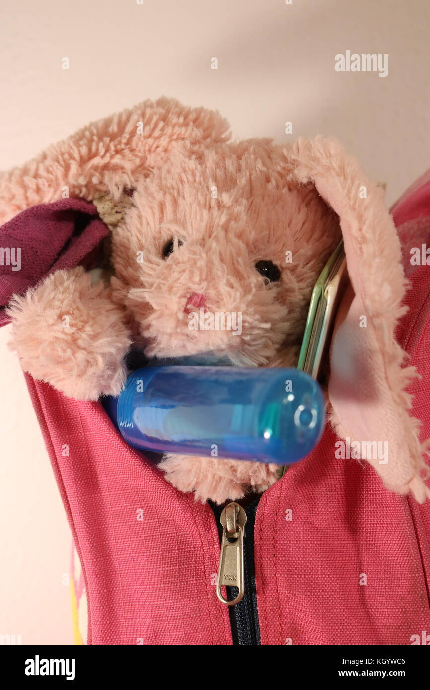 Close up portrait of a girl's packed bag ready for weekend away - Stock Image