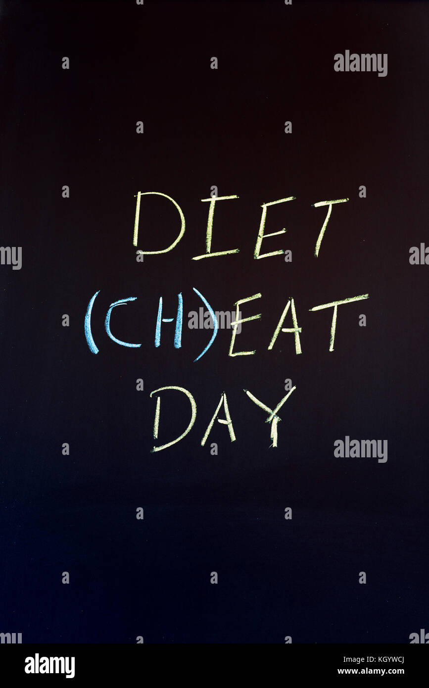 Phrase Diet Cheat Day on dark colored background. - Stock Image