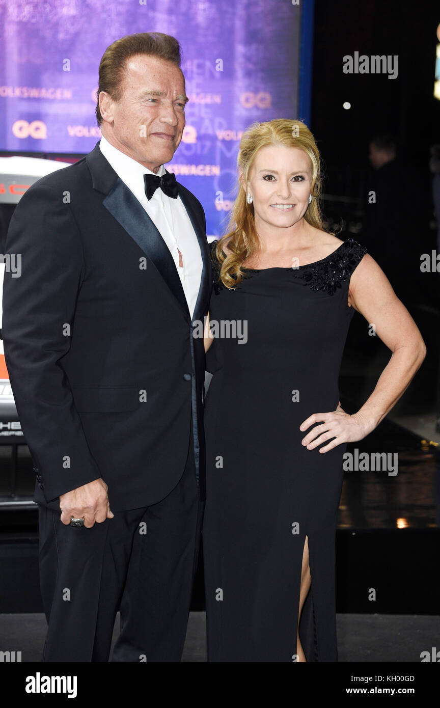 Arnold Schwarzenegger and his girlfriend Heather Milligan attend the 19th GQ Men of the Year Awards 2017 at Komische Stock Photo