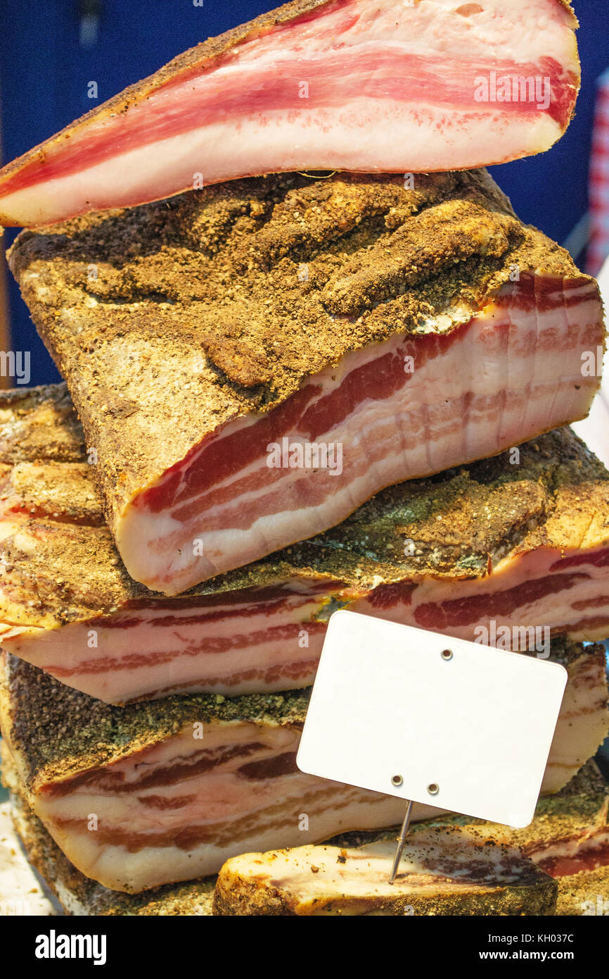 Bacon assortment at the store - with tag - Stock Image