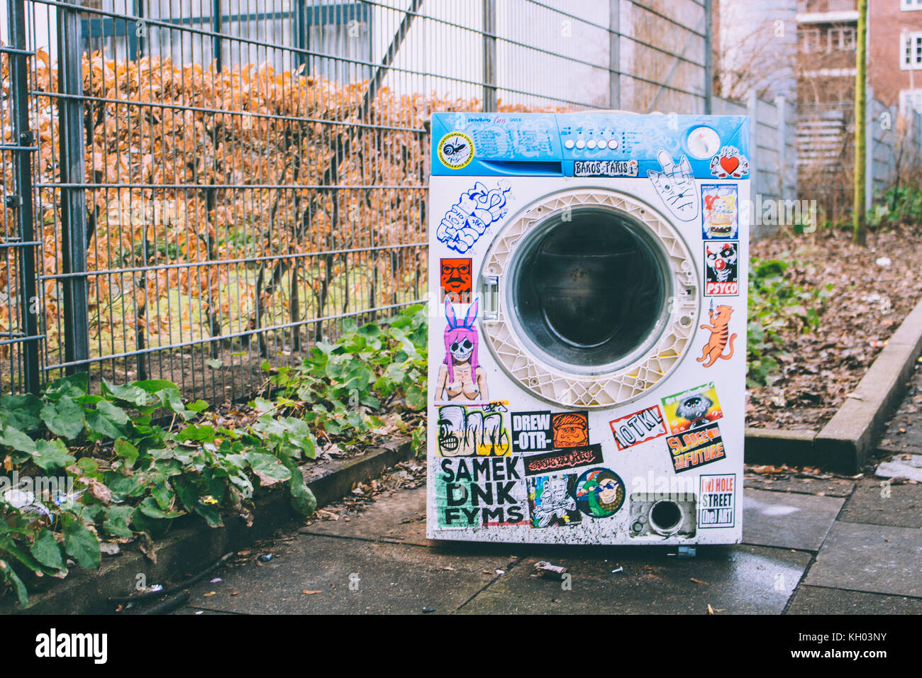 Abandoned Cool Washing Machine At The Side Of A Street With Lots Of Stickers All Over It Stock Photo Alamy