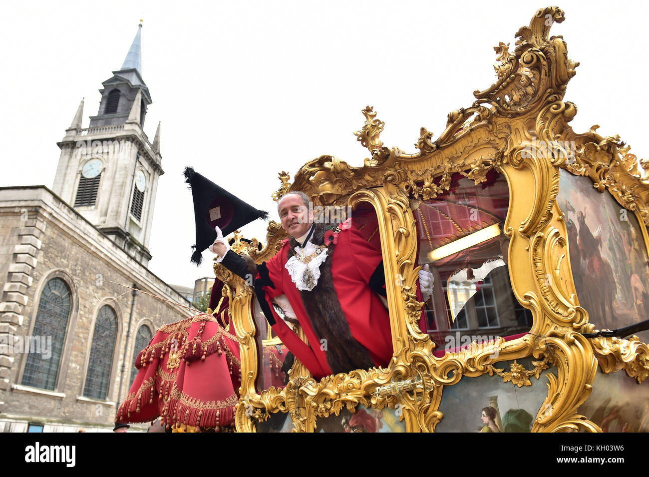 The new Lord Mayor of London Charles Bowman waves from the Lord Mayor's State Coach at Guildhall in London, - Stock Image