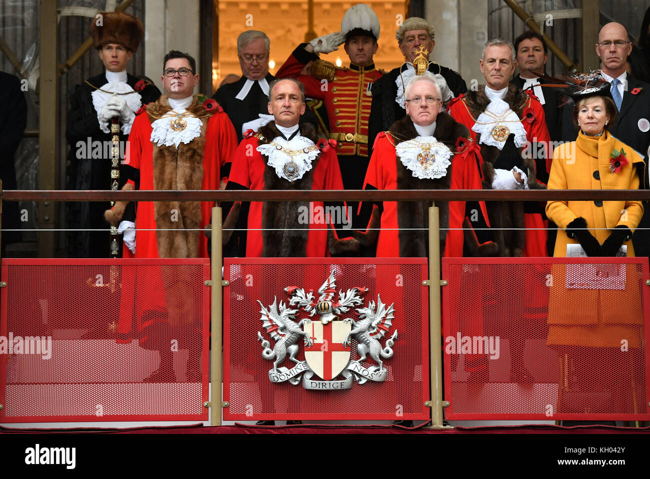 The new Lord Mayor of London Charles Bowman (front left) observes a minute's silence at Guildhall in London, - Stock Image