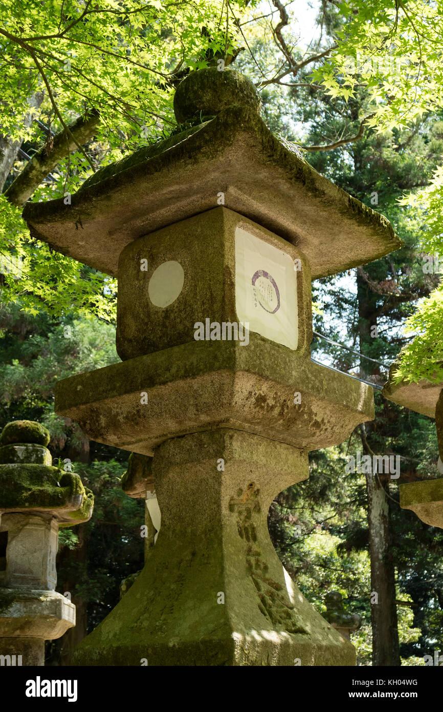 Nara - Japan, May 29, 2017: Stone lantern near the path to the Kasuga Taisha shrine Stock Photo
