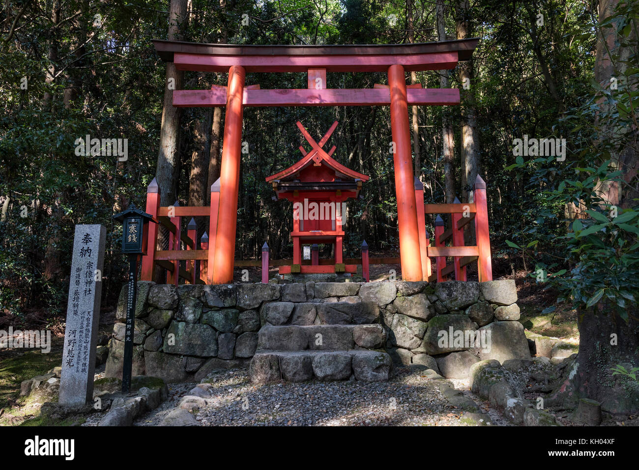 Nara - Japan, May 29, 2017: Torii gate and shinto shrine in the the Kasugayama Primeval Forest, registered as a - Stock Image