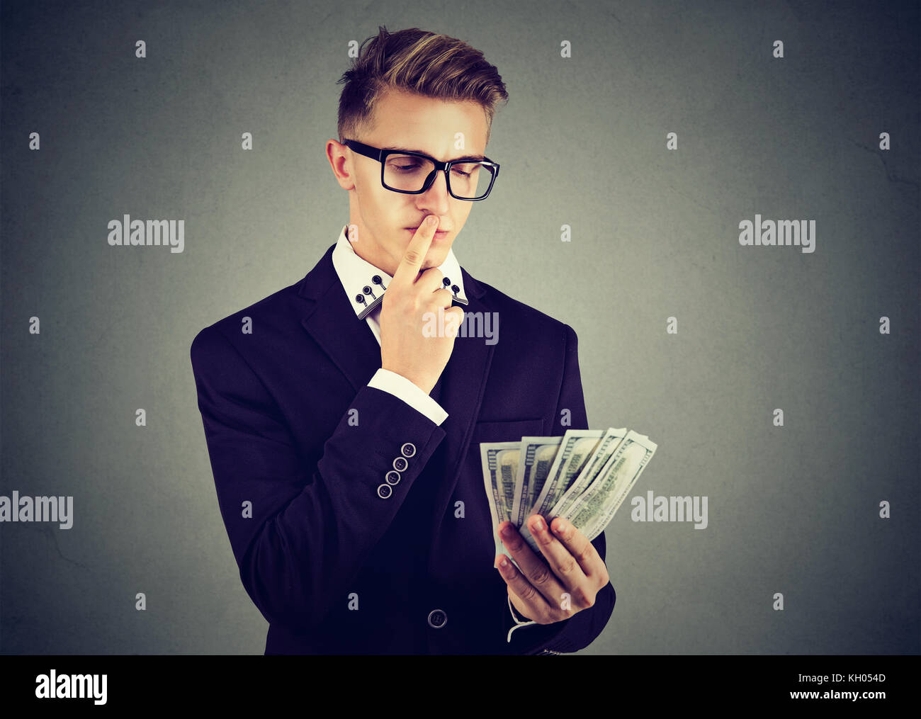 Ambitious young business man with money - Stock Image