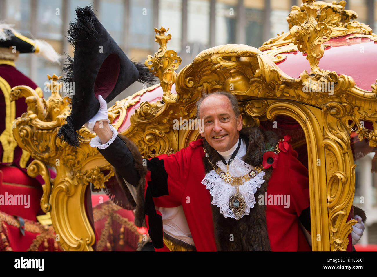 The new Lord Mayor of London Charles Bowman waves from his carriage during the parade at the Lord Mayor's Show - Stock Image