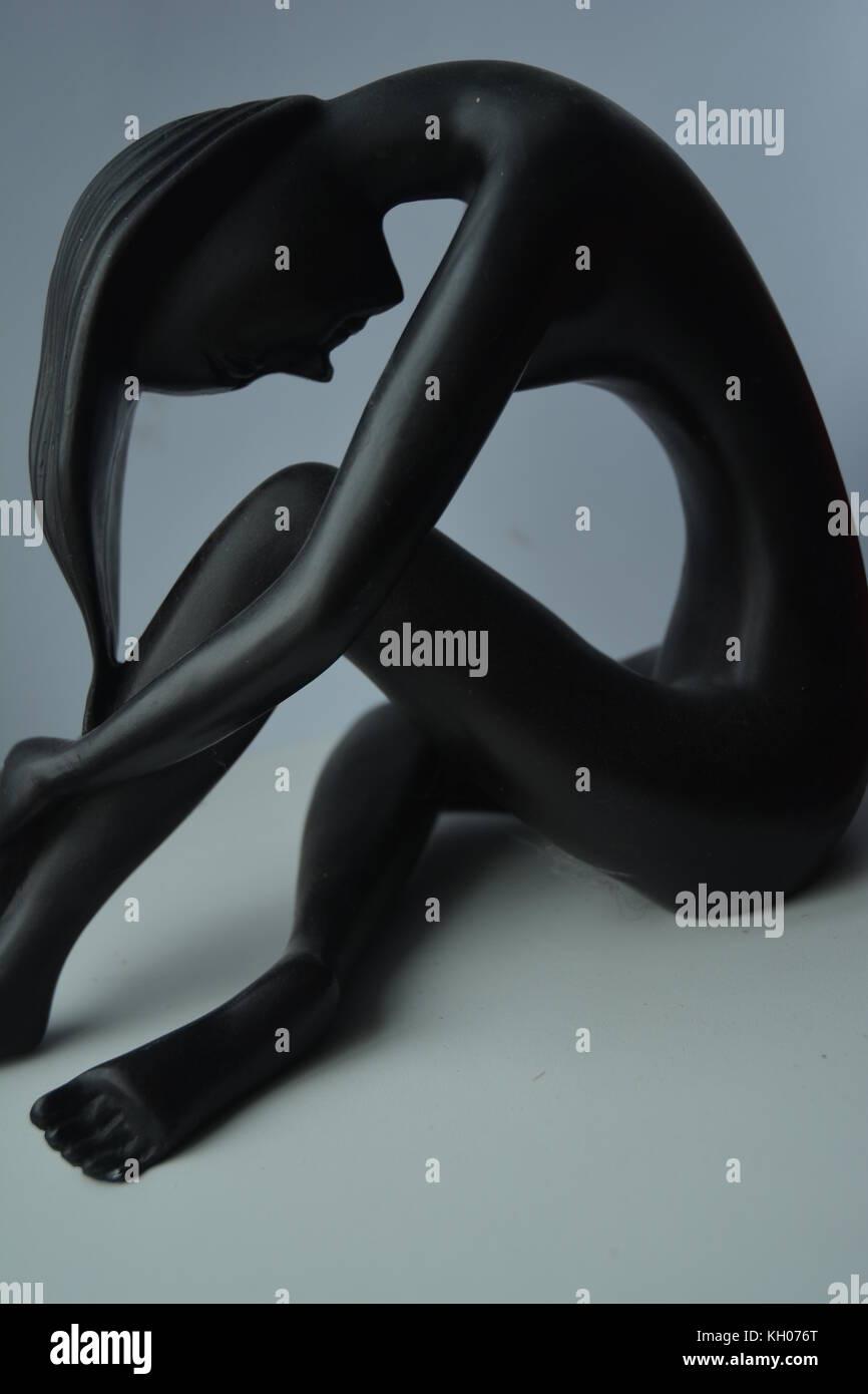 Statuette of human female - Stock Image
