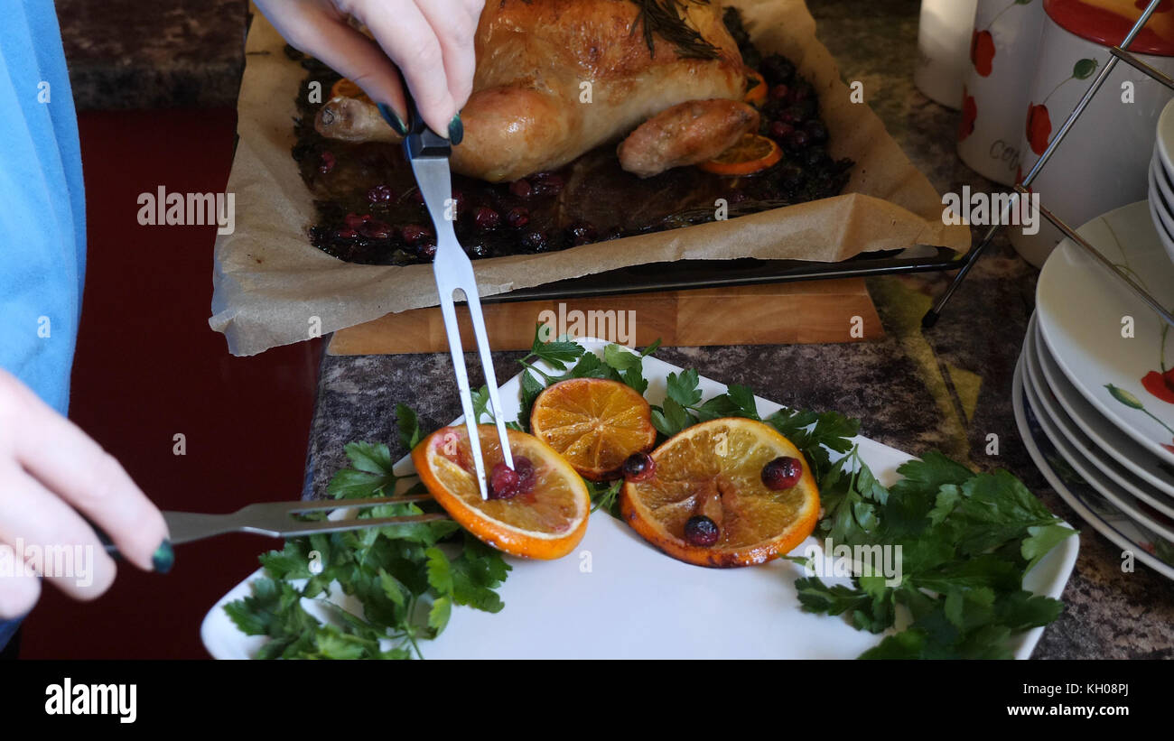 Female Hands Decorate Roasted Whole Chicken on Plate For Family Dinner. & Female Hands Decorate Roasted Whole Chicken on Plate For Family ...