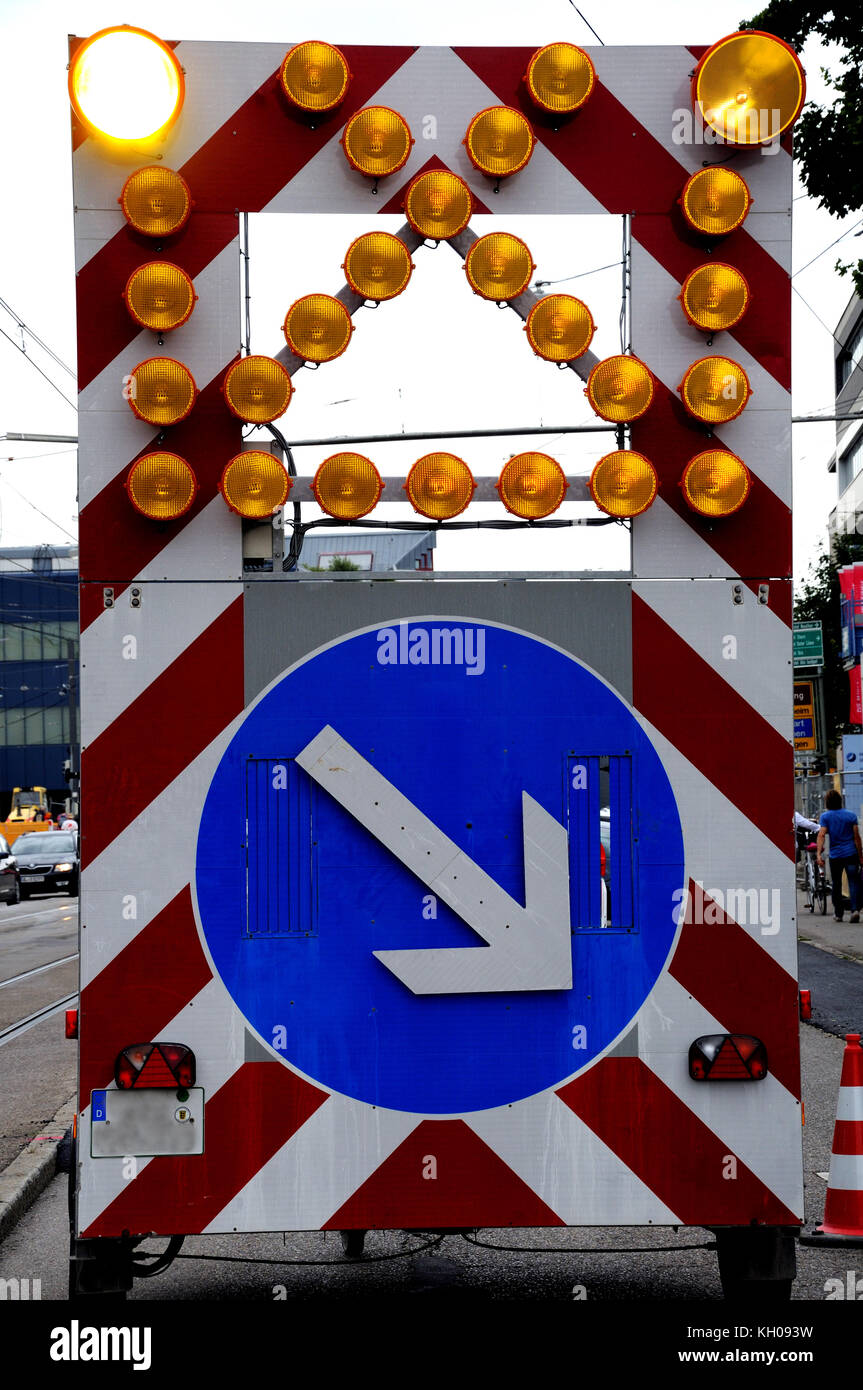 traffic sign and warning lamps at construction site - Stock Image
