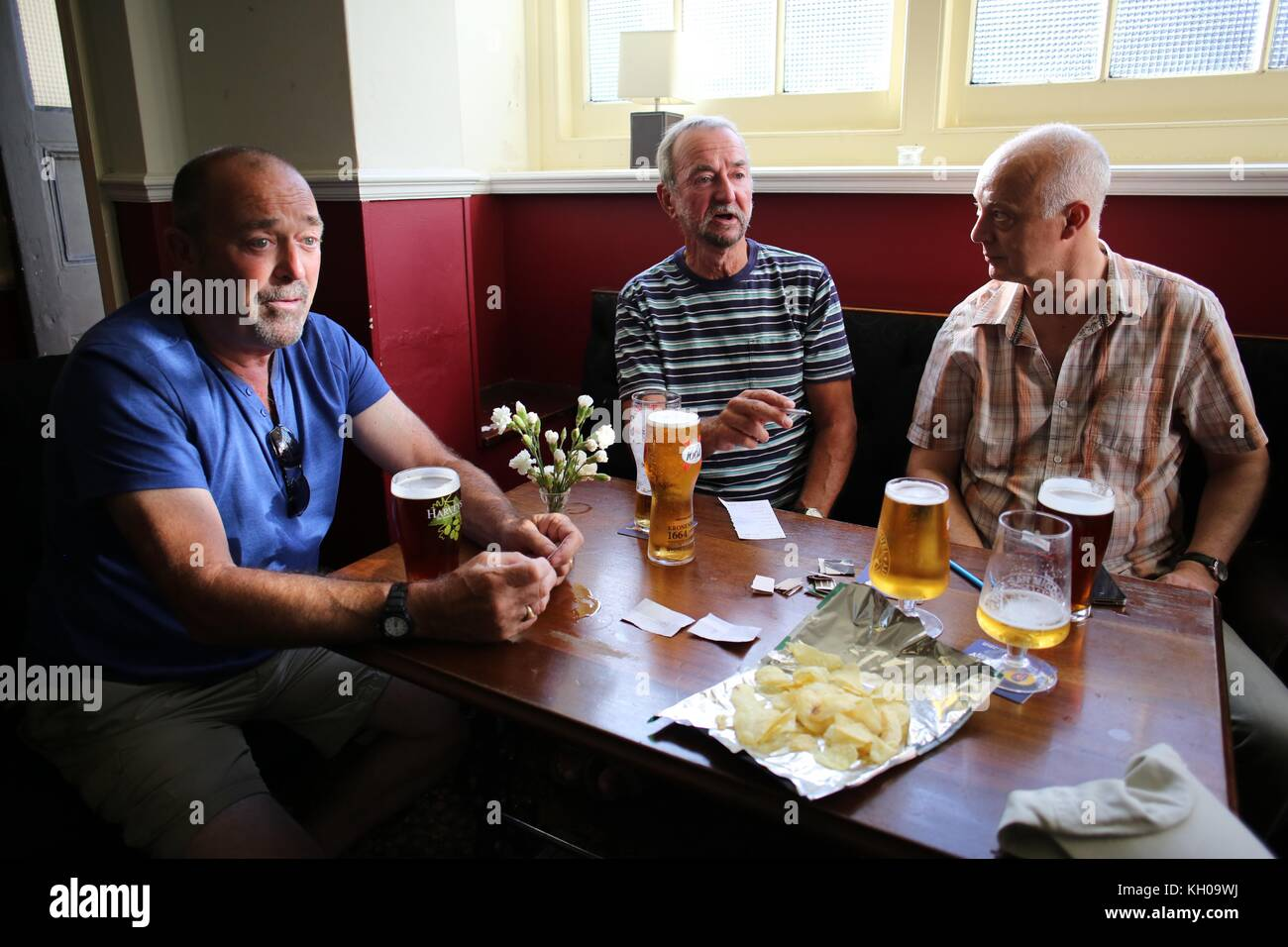 Regulars enjoying themselves in the Cleveland Arms Pub in Brighton. Picture by James Boardman - Stock Image