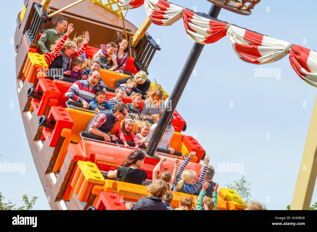 WINDSOR, BERKSHIRE. ENGLAND UK- APRIL 20 2016 : Legoland resort. People enjoying one of the many rides at Legoland Stock Photo