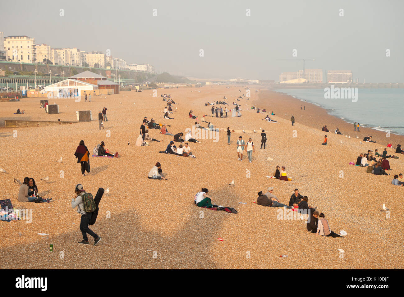A Hazy day on Brighton Beach, UK - Stock Image