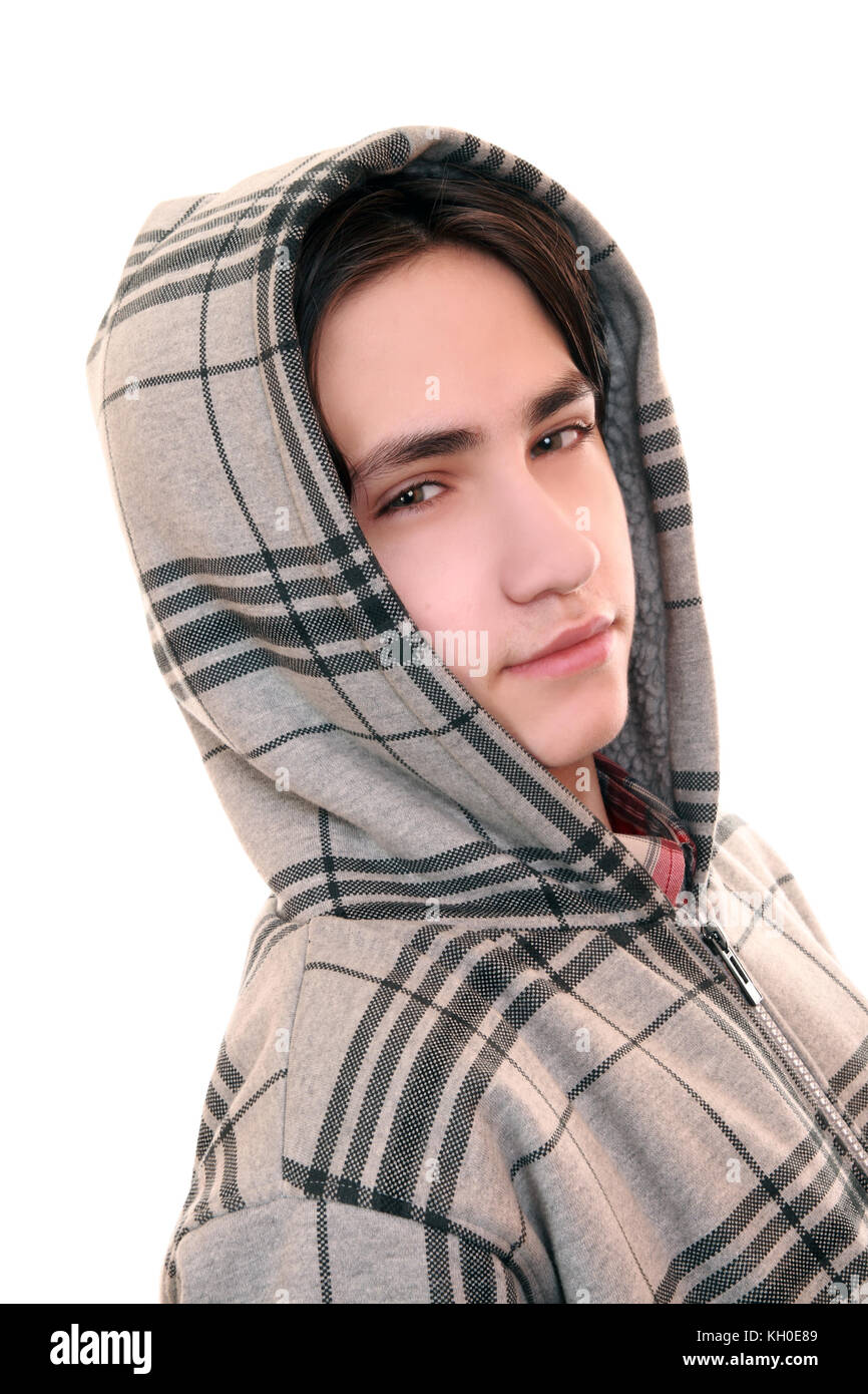 Distrustful sullen teenager isolated on a white background - Stock Image