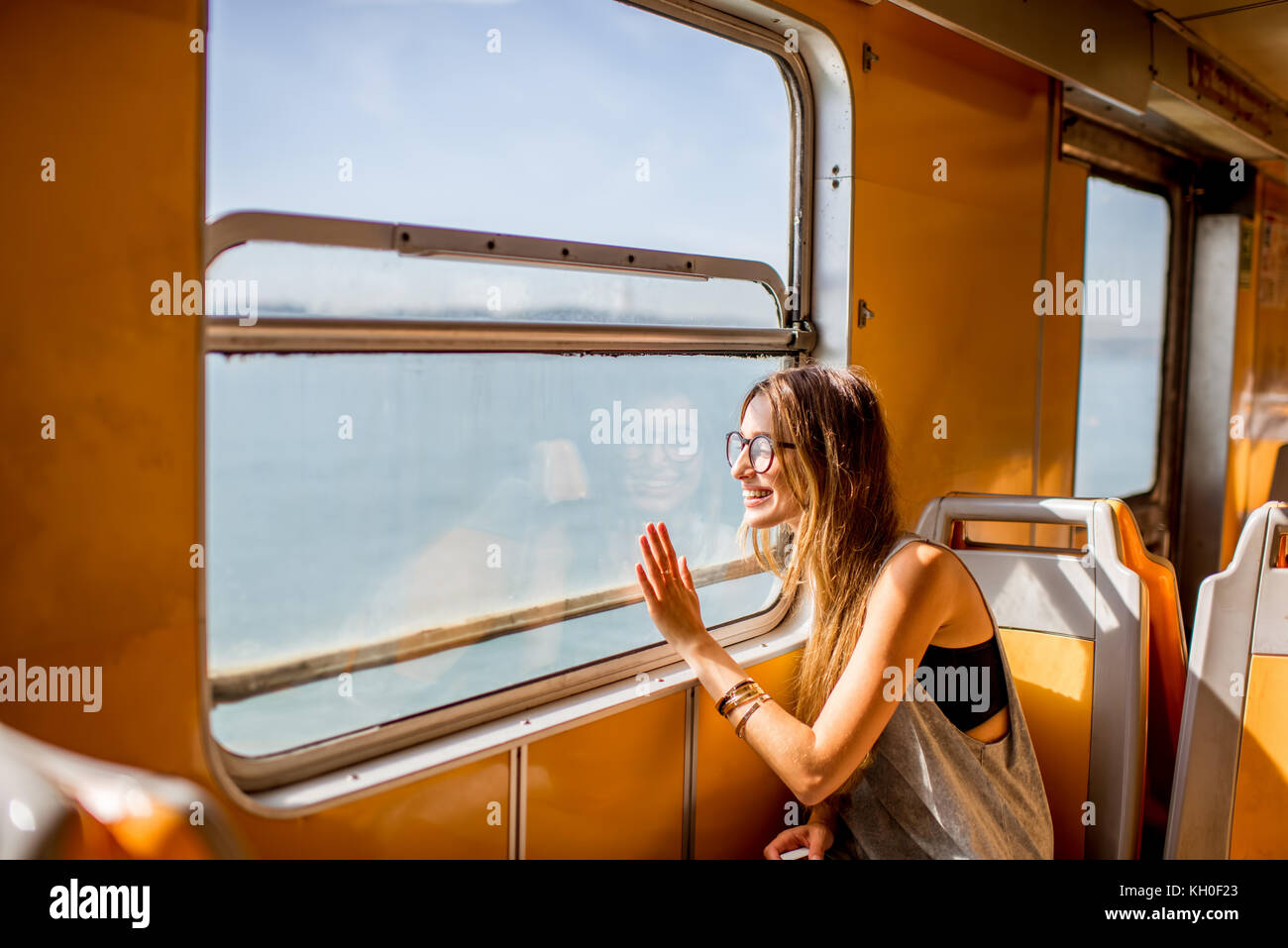 Woman traveling in ferry - Stock Image