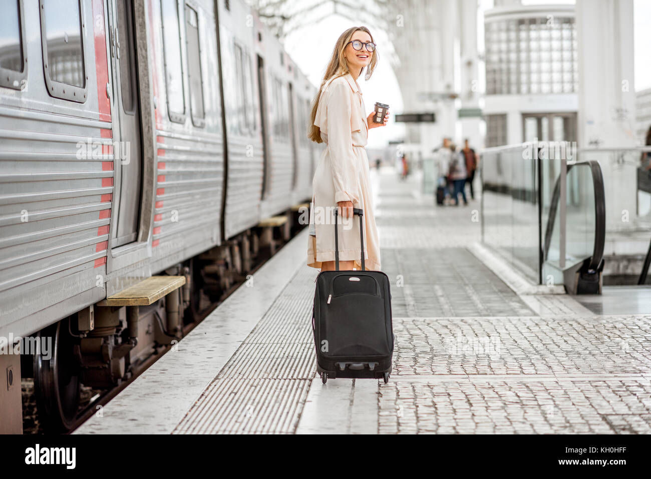 Woman at the railway station - Stock Image