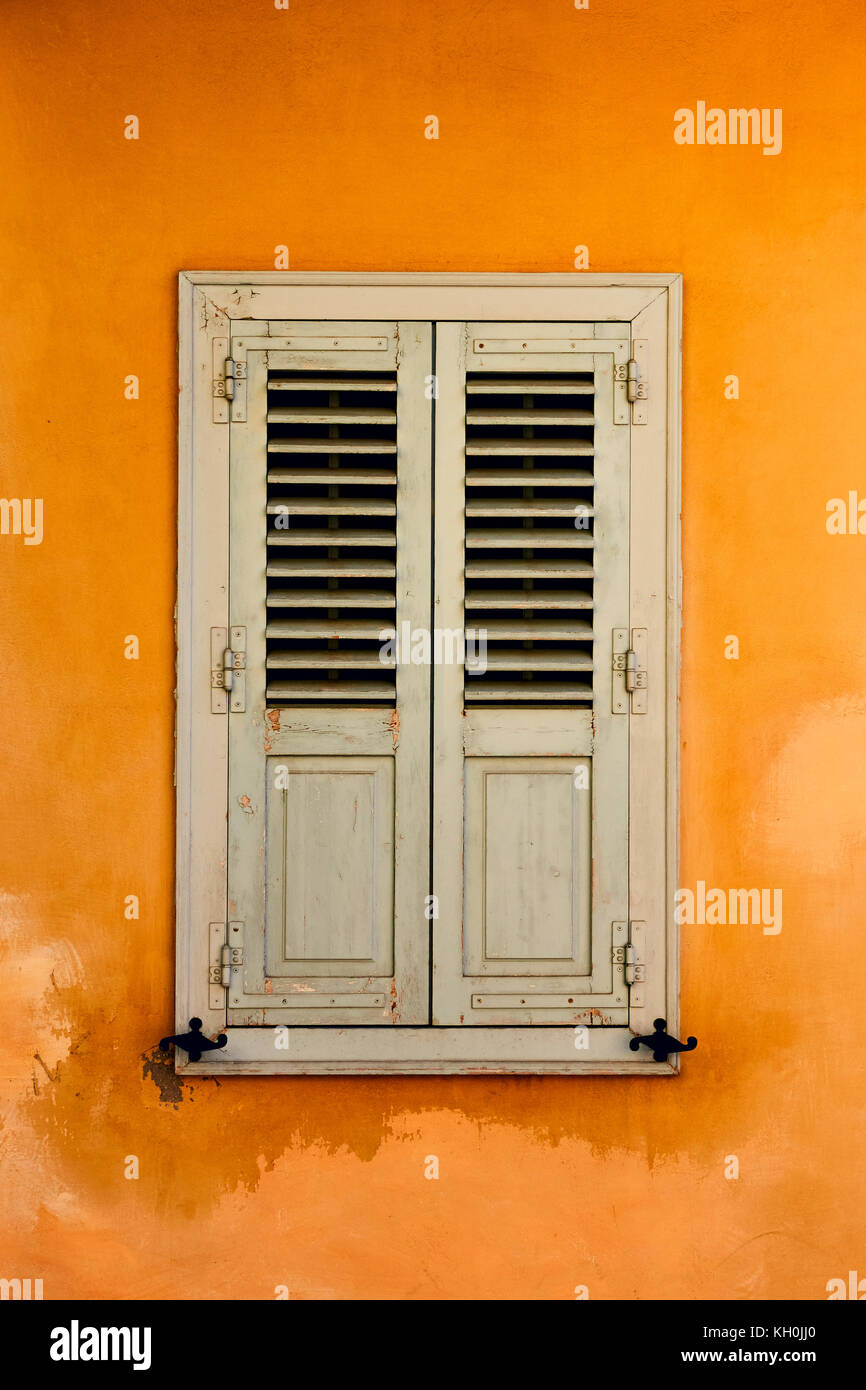 Window with shutters in Plaka district in Athens, Greece - Stock Image