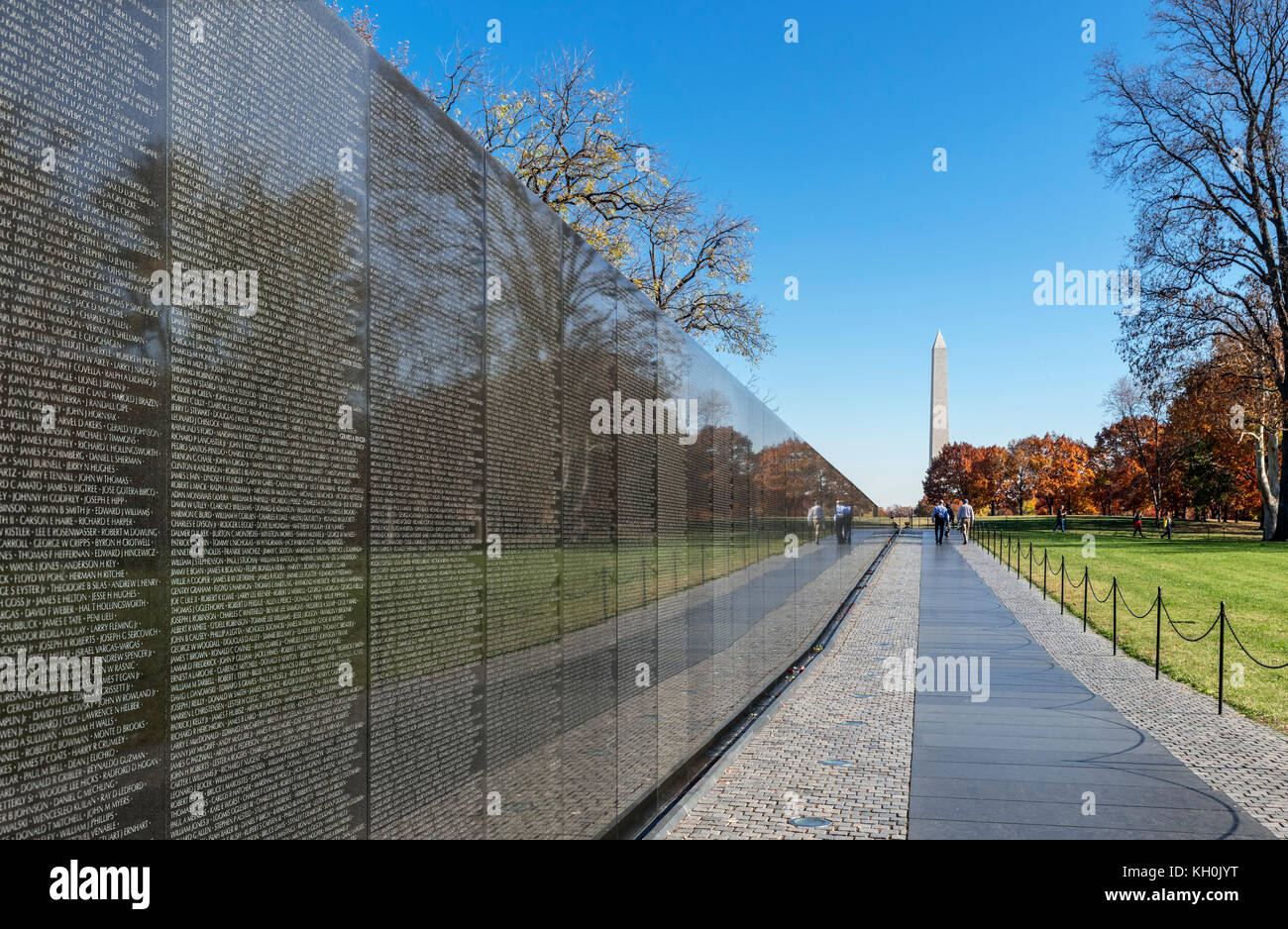 The Memorial Wall at the Vietnam Veterans Memorial with the Washington Monument in the distance, Washington DC, - Stock Image
