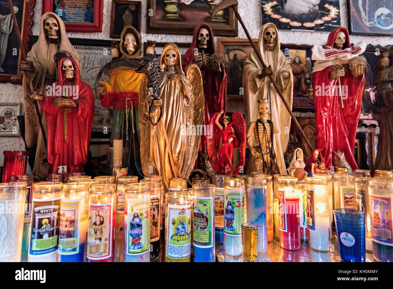 A shrine and offerings inside the La Casa De La Santa Muerte or