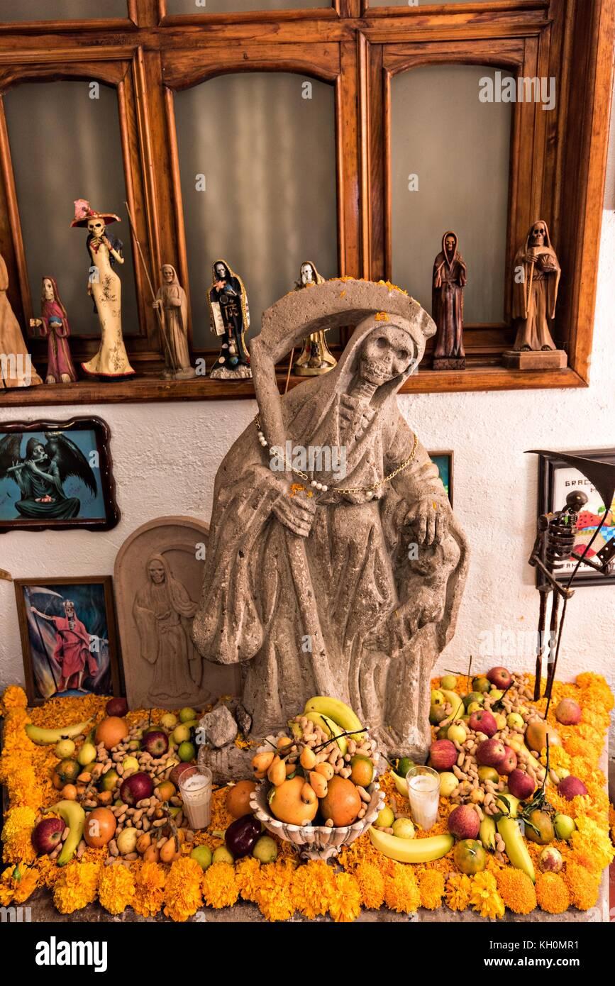A shrine and offerings to Santa Muerte inside the La Casa De La