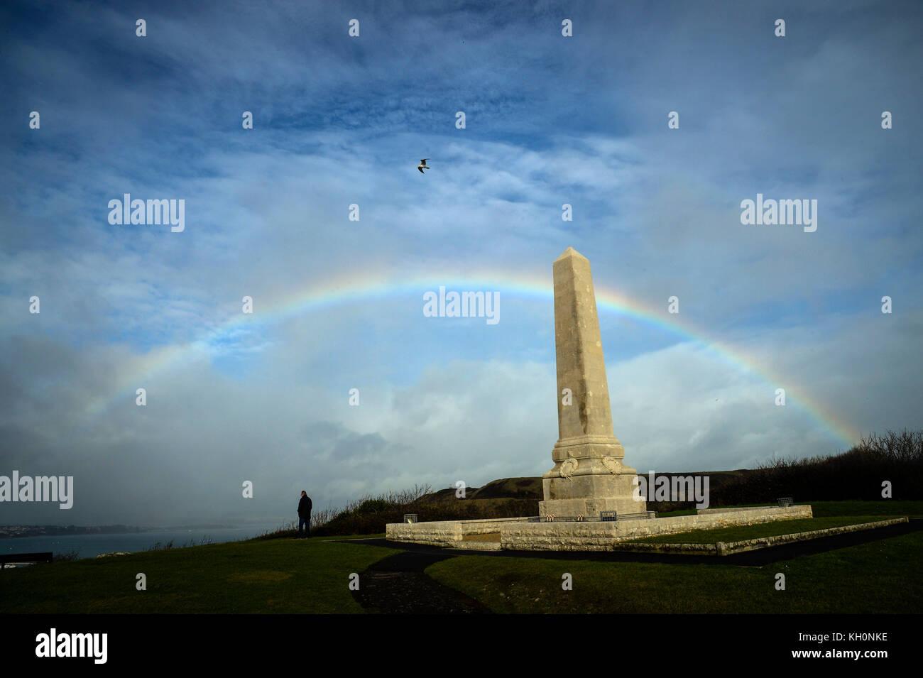 Rainbow over Portland Cenotaph War Memorial, Dorset, UK Credit: Finnbarr Webster/Alamy Live News - Stock Image