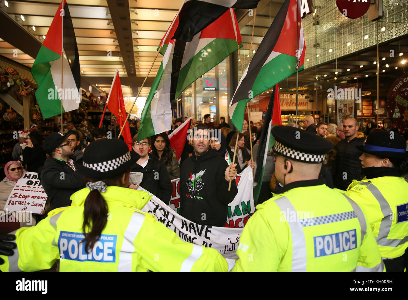 Manchester, UK. 11th Nov, 2017. Police form a line to prevent Pro Palestinian activists from marching near Marks - Stock Image