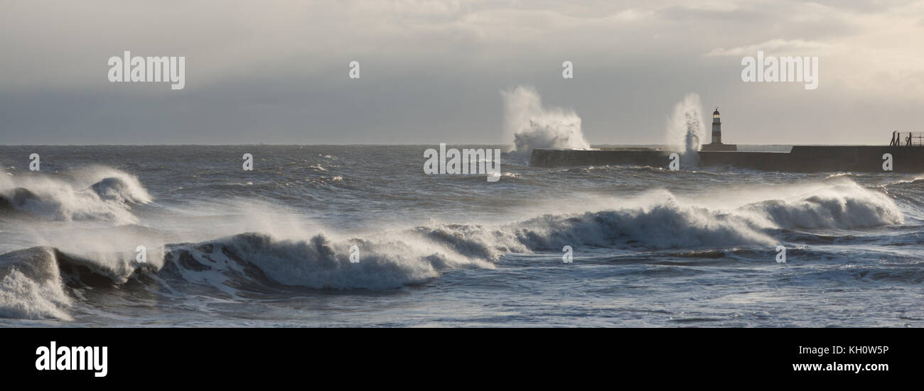 12th November 2017. Seaham, Sunderland. UK. The wind whips up the sea as high waves batter the harbour walls at - Stock Image