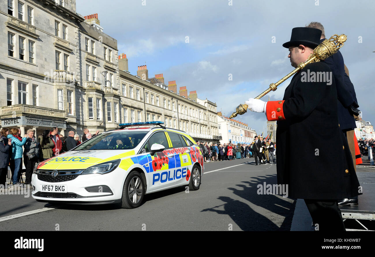 Poppy branded police car at Remembrance Day service, Weymouth, Dorset, UK Credit: Finnbarr Webster/Alamy Live News - Stock Image