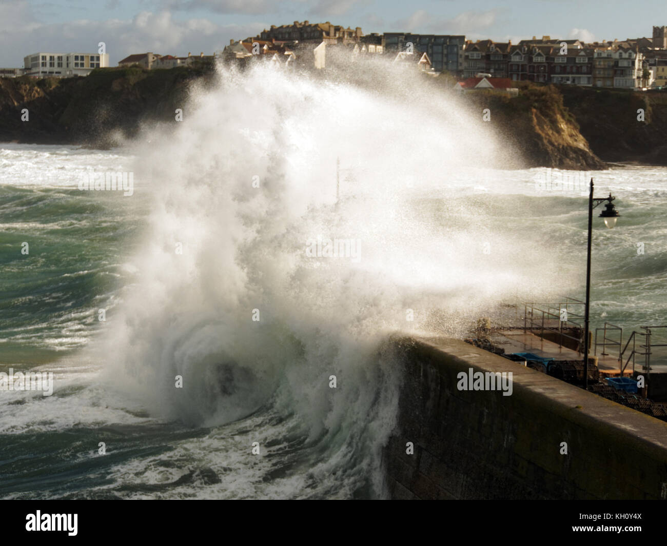 Newquay, UK. 12th Nov, 2017. UK weather Northerly rough seas pound Cornish coast drawing spectators and daredevils.12th, - Stock Image