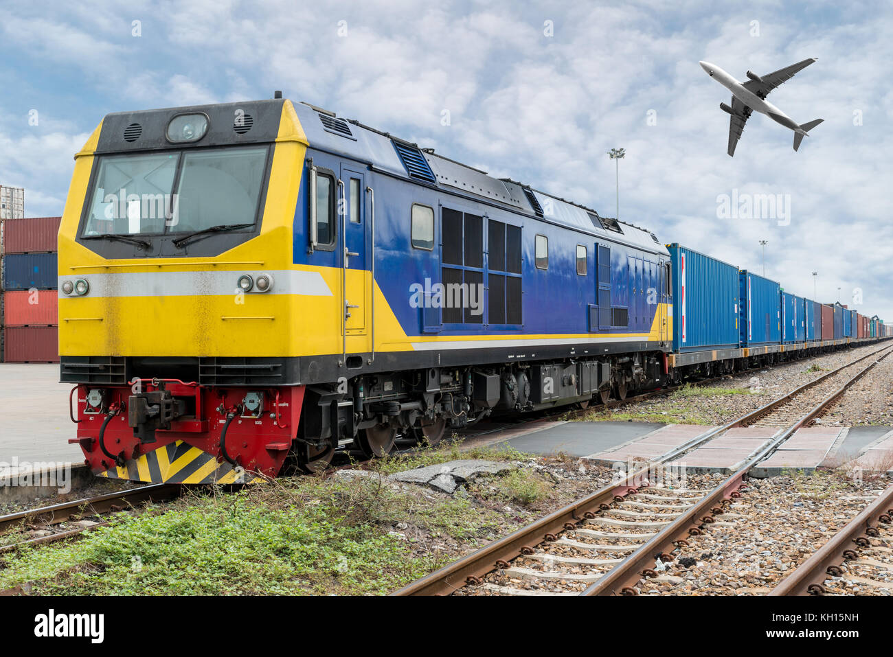 Cargo train platform with freight train container with cargo airplane at depot in port use for export logistics - Stock Image