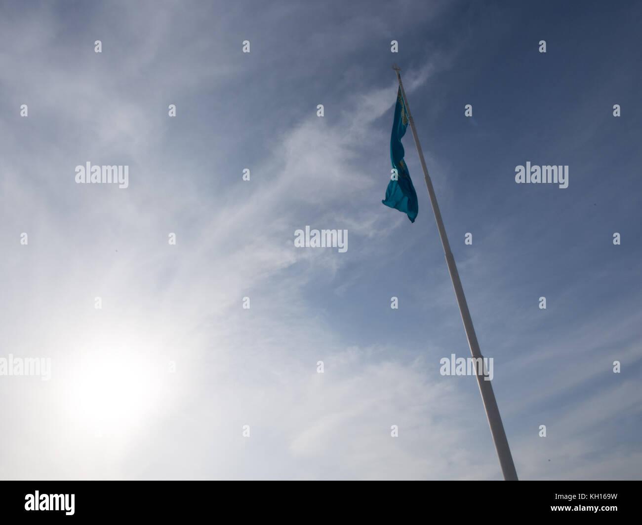 Business Kazakhstan, Flag of Kazakhstan Against a Blue Sky in the Wind, Blue Flag of Kazakhstan, Aktau Kazakhstan, - Stock Image