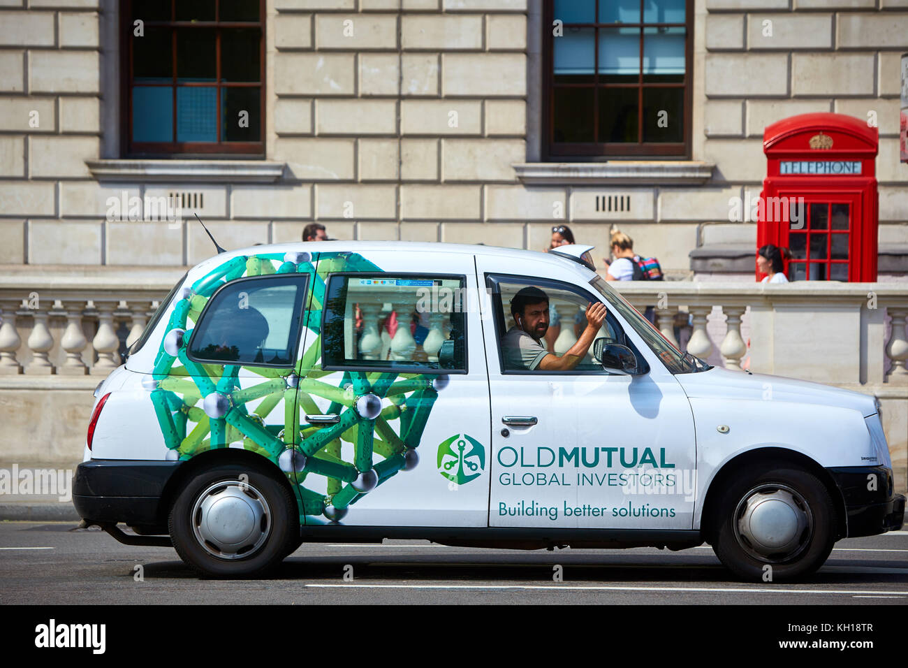 A London Hackney Carriage advertising Old Mutual - Stock Image
