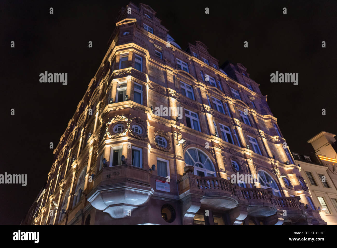 Beautiful buildings at Leicester Square in London at night - Stock Image