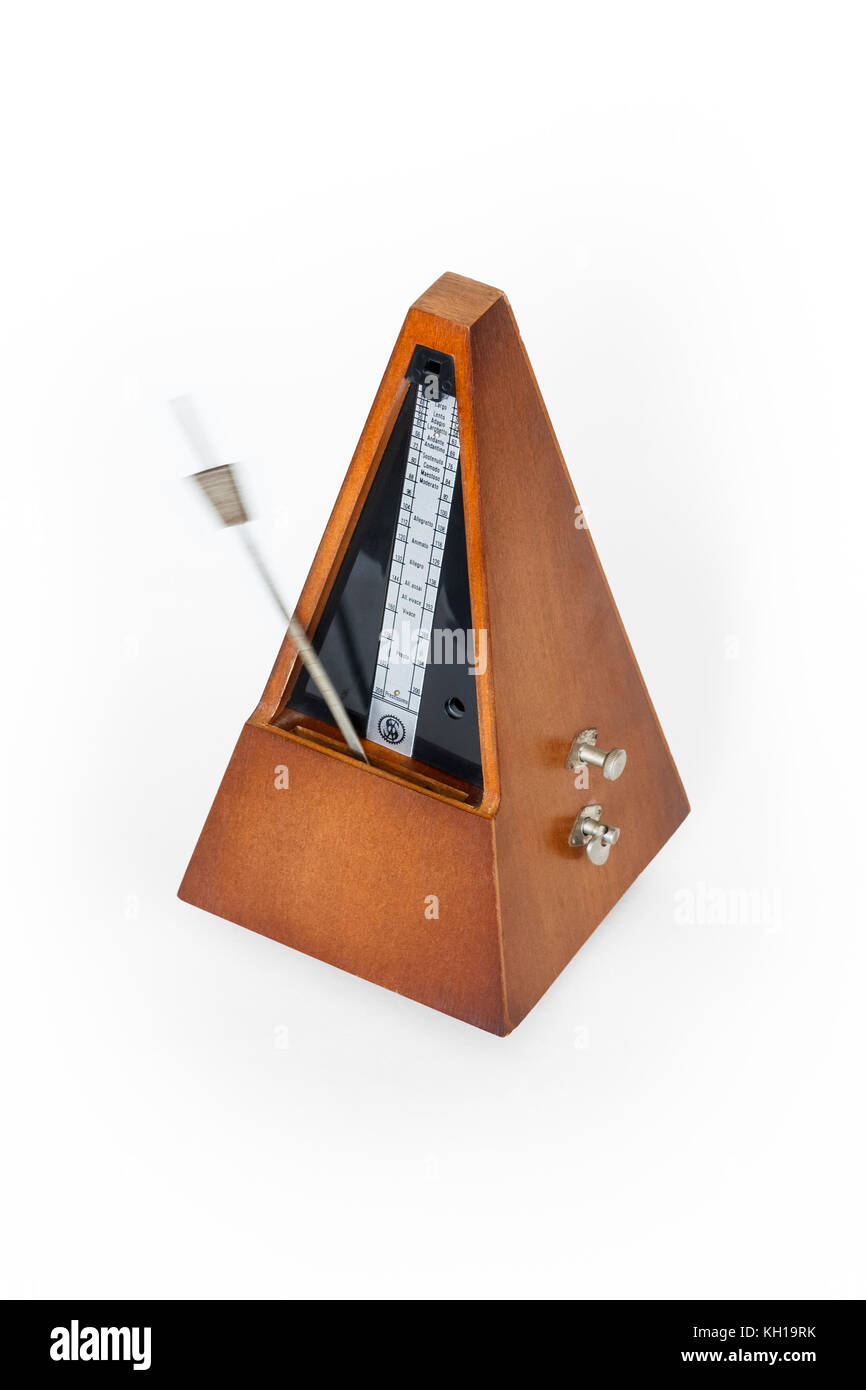 A traditional wooden clockwork Maelzel pyramid metronome against a white background, 1970s - Stock Image