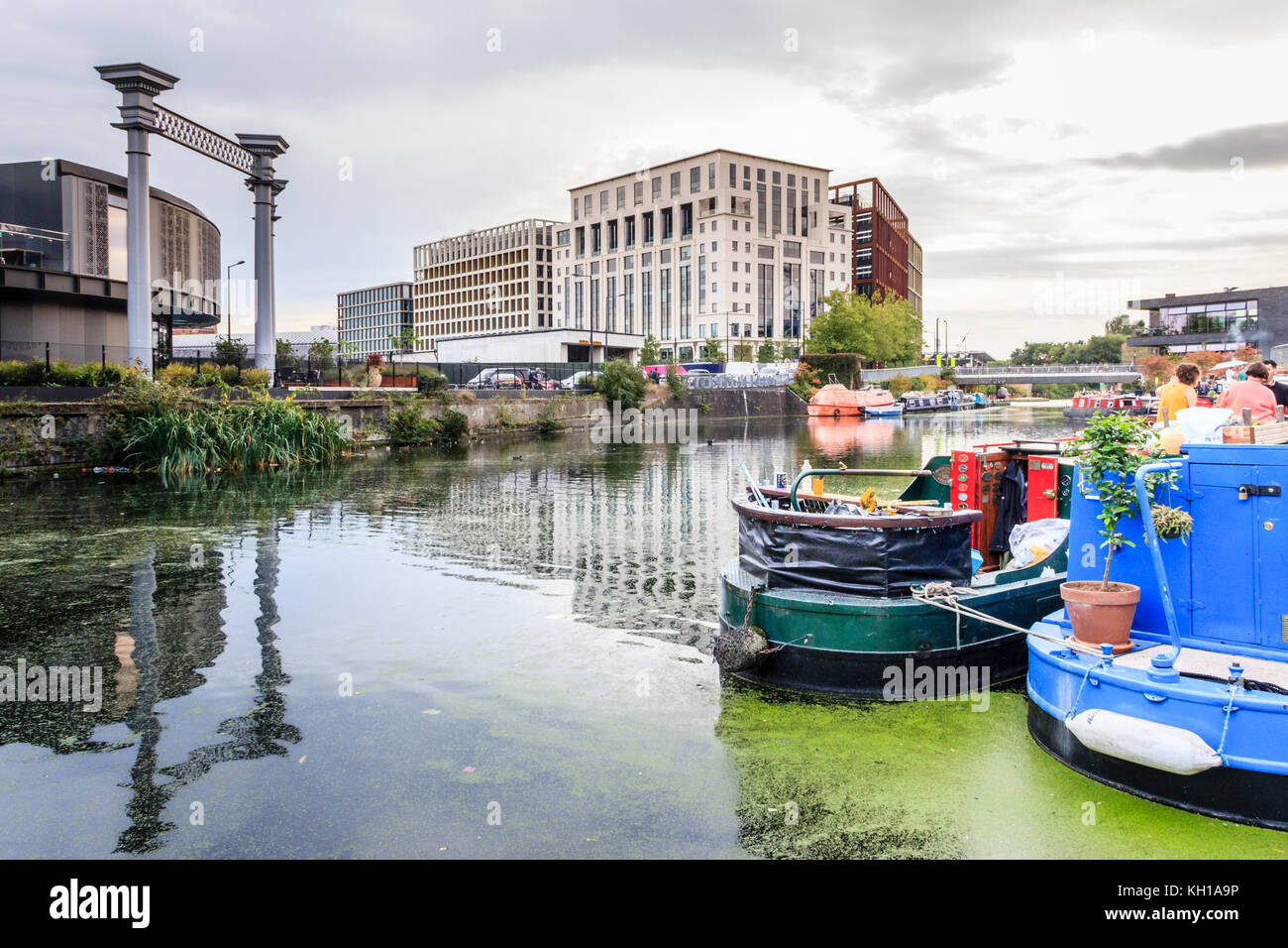 Evening reflections on Regent's Canal at King's Cross, London, UK, the Filling Station restaurant on the - Stock Image