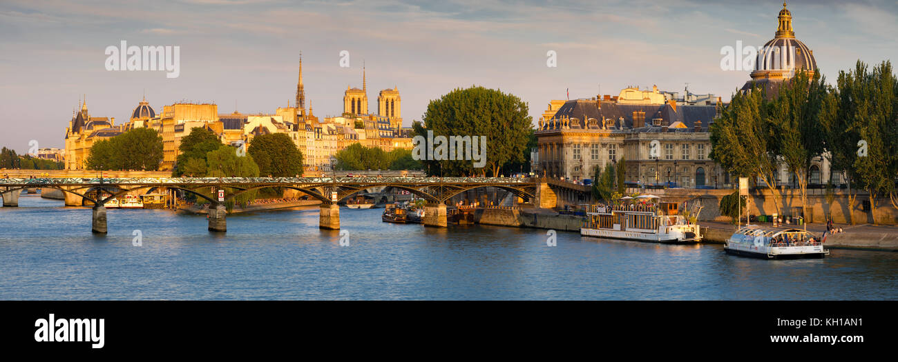 Panoramic view of the Seine River and Left Bank at Sunset with Ile de la Cite, Pont des Arts and the French Institute. - Stock Image