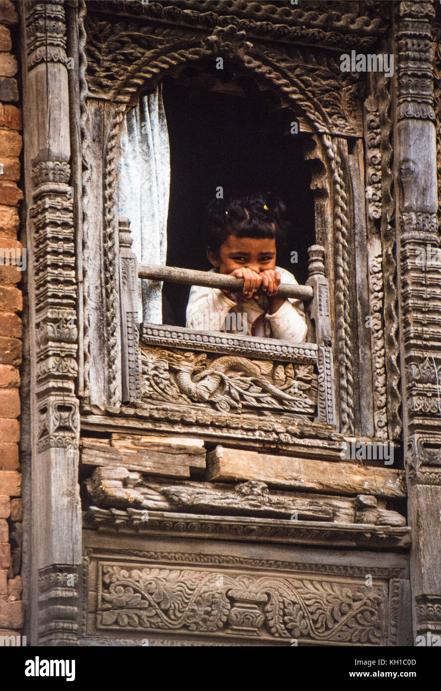 Nepali Girl in Window - Stock Image