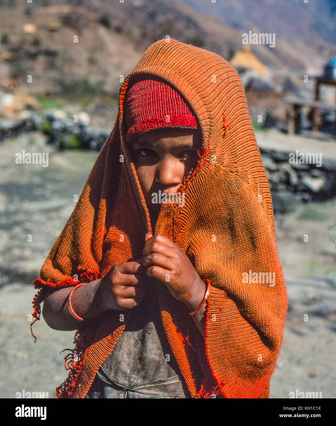 Nepali Child Covering Her Head - Stock Image