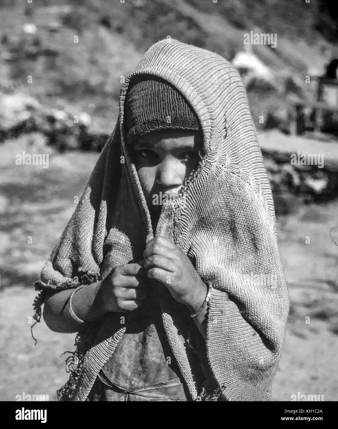 Nepali Child Covering Her Head - Black and White - Stock Image