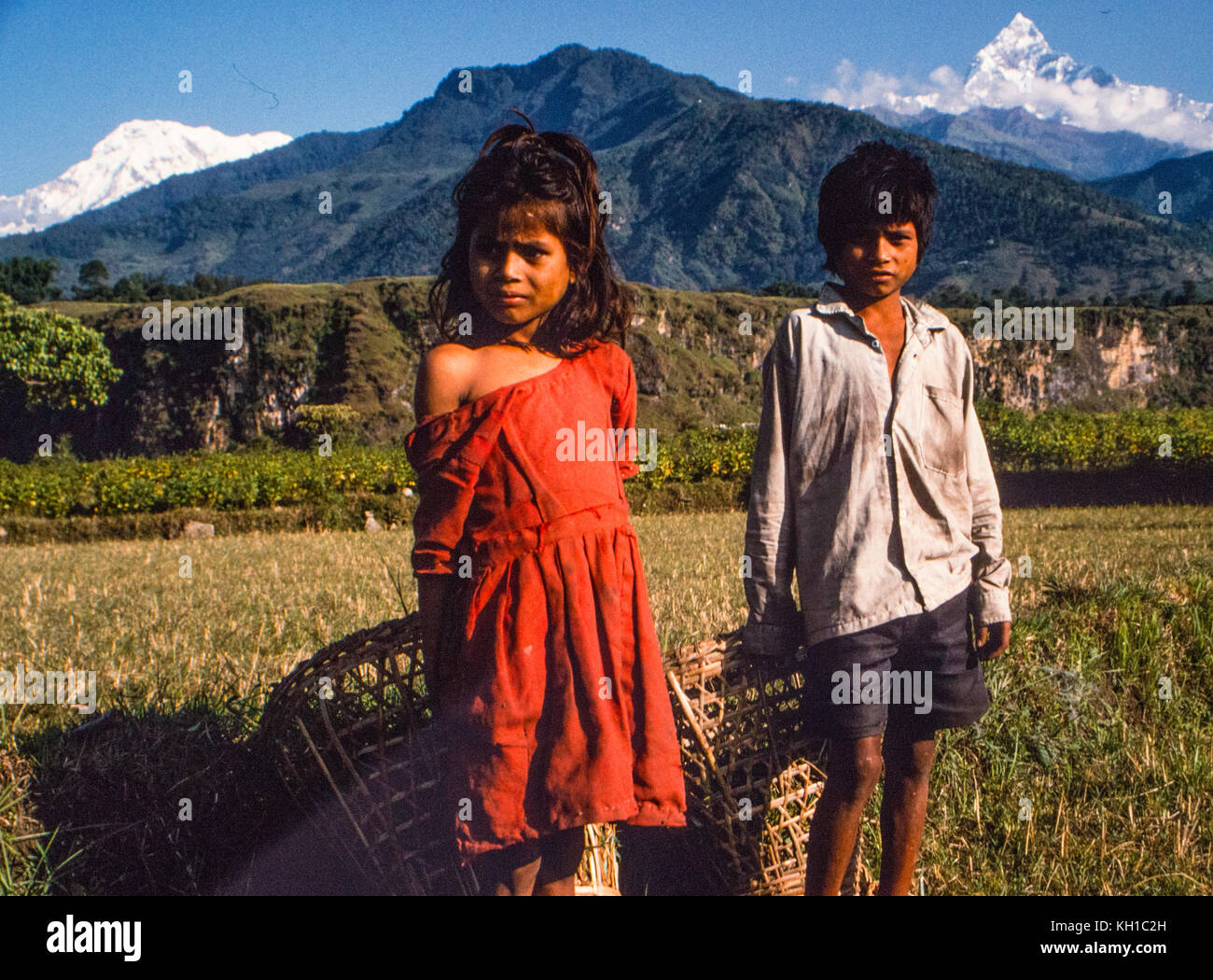 Nepali Children with Baskets - Stock Image