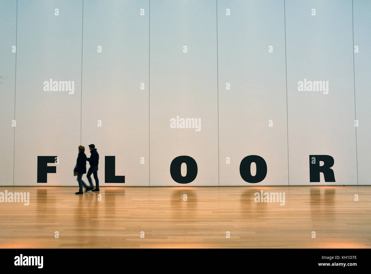 The Word Floor In Large Black Letters On A Off White Wall And