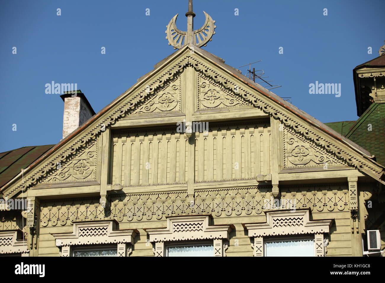 carved pattern wooden gable rustic house - Stock Image