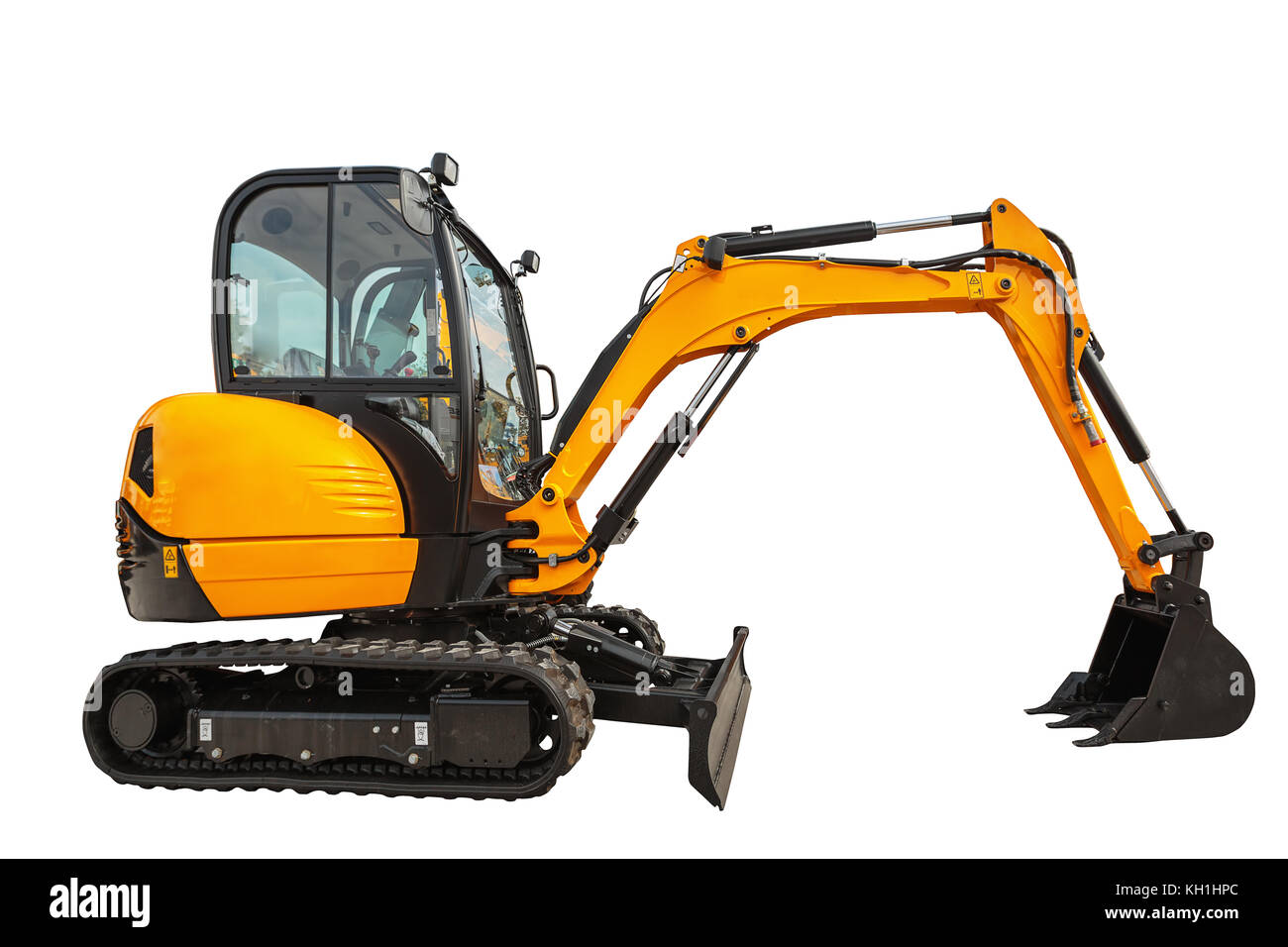 Small or mini excavator with clipping path isolated on white background - Stock Image